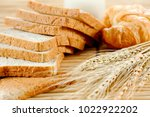 bread and wheat  foods high in... | Shutterstock . vector #1022922202