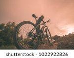 cyclist riding mountain bike on ... | Shutterstock . vector #1022922826
