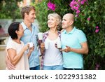 happy cheerful  mature couples... | Shutterstock . vector #1022931382