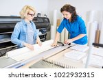 portrait of two modern young... | Shutterstock . vector #1022932315