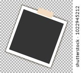 photo frame with sticky tape on ... | Shutterstock .eps vector #1022945212