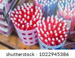 red pens in a container... | Shutterstock . vector #1022945386