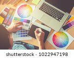 graphic designer drawing on... | Shutterstock . vector #1022947198