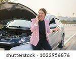 broken car  beautiful  asian... | Shutterstock . vector #1022956876