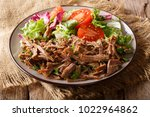 spicy pulled beef with... | Shutterstock . vector #1022964862