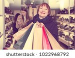 adult woman is showing bags...   Shutterstock . vector #1022968792