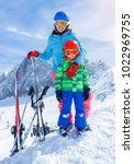 cute happy skier boy with his... | Shutterstock . vector #1022969755