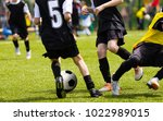 soccer players competing for... | Shutterstock . vector #1022989015