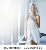 brunette beauty wearing white...   Shutterstock . vector #1023004516