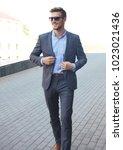handsome stylish man in elegant ... | Shutterstock . vector #1023021436