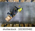 warehouse workers after an... | Shutterstock . vector #1023035482