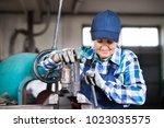 senior female mechanic... | Shutterstock . vector #1023035575