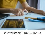 hand woman cleaning glasses... | Shutterstock . vector #1023046435