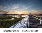 old wooden dock leading to a... | Shutterstock . vector #1023049885