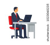 businessman sitting at desk... | Shutterstock .eps vector #1023060235