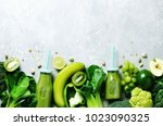green smoothie in glass jar... | Shutterstock . vector #1023090325