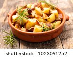 fried potato and rosemary | Shutterstock . vector #1023091252