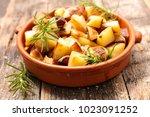 fried potato and rosemary   Shutterstock . vector #1023091252