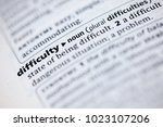 Small photo of Close up to the dictionary definition of Difficulty