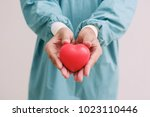 red heart on the doctor hand... | Shutterstock . vector #1023110446