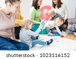 young moms with their kids | Shutterstock . vector #1023116152