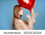 young woman with a red ball on... | Shutterstock . vector #1023116326