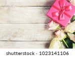 gift and flowers. selective... | Shutterstock . vector #1023141106