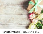 gift and flowers. selective... | Shutterstock . vector #1023141112