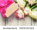 gift and flowers. selective... | Shutterstock . vector #1023141262