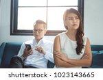 beautiful asian girl feel angry ... | Shutterstock . vector #1023143665