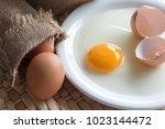 Fresh Broken Egg With Yolk On...