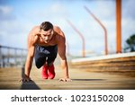 athletic man doing push ups... | Shutterstock . vector #1023150208