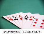 playing poker cards and money | Shutterstock . vector #1023154375