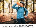 sport. a cyclist on a bike with ... | Shutterstock . vector #1023184078