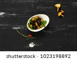 black and green olives in bowl... | Shutterstock . vector #1023198892