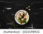 tasty vegetarian salad made of... | Shutterstock . vector #1023198922