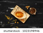 tasty creamy pumpkin soup in... | Shutterstock . vector #1023198946