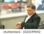 impatient traveler at station... | Shutterstock . vector #1023199042