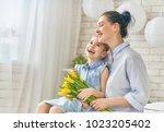 happy women's day  child... | Shutterstock . vector #1023205402