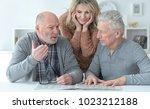 senior people reading newspaper   Shutterstock . vector #1023212188