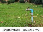 water supply valve in the green ... | Shutterstock . vector #1023217792
