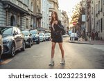 beautiful girl with backpack on ... | Shutterstock . vector #1023223198