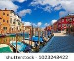 burano island in venice italy... | Shutterstock . vector #1023248422