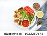 vegan food. fried tofu with... | Shutterstock . vector #1023250678