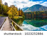 the smooth surface of the water ... | Shutterstock . vector #1023252886
