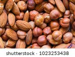nuts pile background. cashew ... | Shutterstock . vector #1023253438