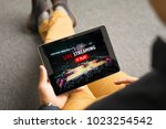 man watching sports on live... | Shutterstock . vector #1023254542