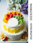 wedding cake with fresh fruits | Shutterstock . vector #1023258046