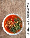 Small photo of Traditional Maghreb, Moroccan and Algerian tomato soup Harira. Ramadan food. Traditional Jewish cuisine.