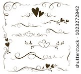 Vector set of floral calligraphic elements, dividers and love ornaments for page decoration and frame design. Decorative heart silhouette for wedding cards and invitations.   | Shutterstock vector #1023272842